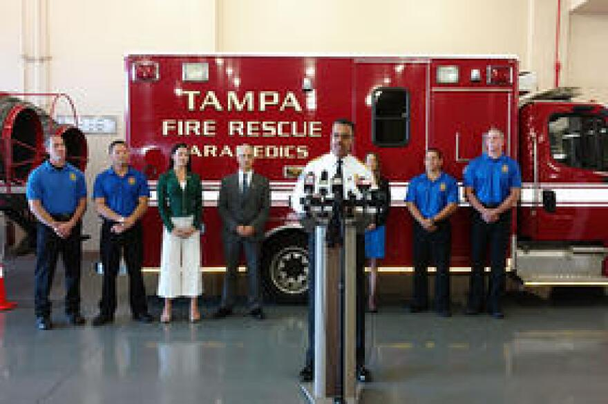 Tampa firefighters and USF Health officials, led by TFR Chief Tom Forward (at podium) announce the study at an April 11 press conference in TFR Station 1.