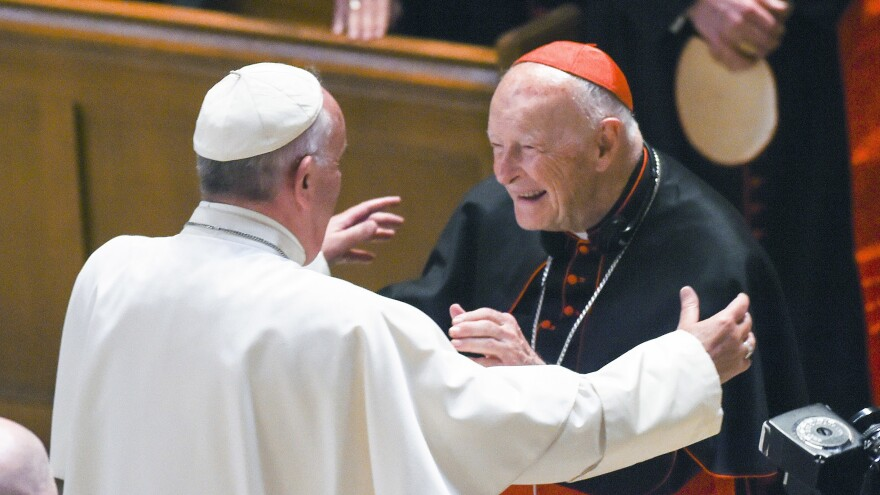 Pope Francis embraces then-Cardinal Theodore McCarrick during a 2015 visit to the U.S. McCarrick resigned the cardinalate last year before being defrocked Saturday.