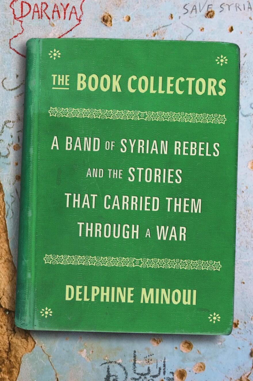 <em>The Book Collectors: A Band of Syrian Rebels and the Stories That Carried Them Through a War,</em> by Delphine Minoui