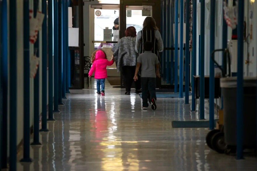 Students and teachers walk through the halls at Cactus Elementary School.