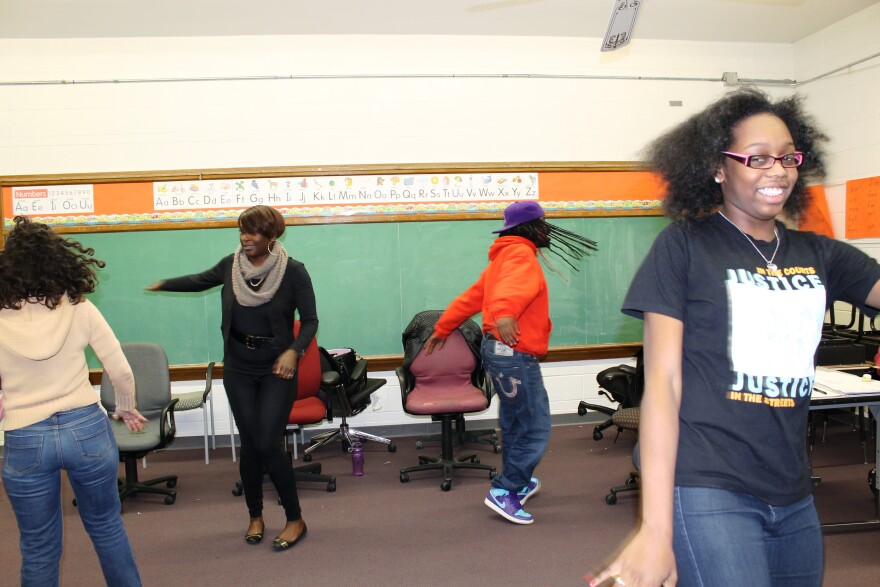 Diana Barrios, with back turned, leads a theater exercise with, clockwise, Chocolate Gowdey, Bud Cuzz and Valerie Felix.