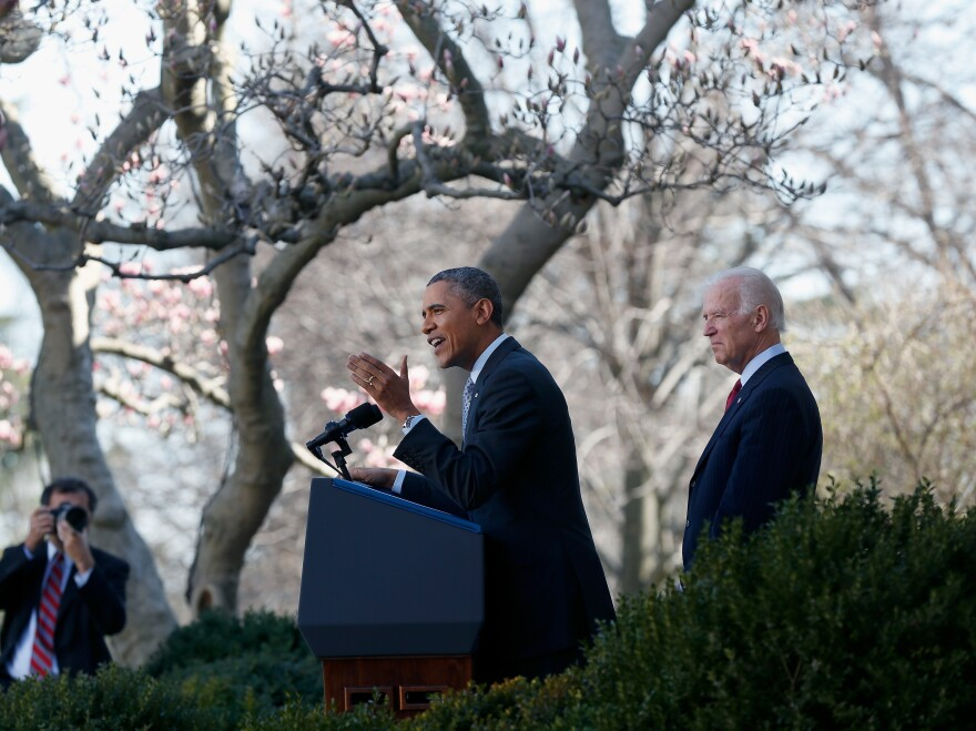 President Obama speaks about the Affordable Care Act as Vice President Joe Biden watches in the Rose Garden of the White House on Tuesday.