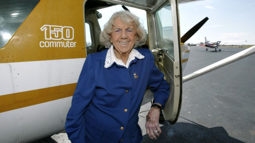 "Evelyn ""Mama Bird"" Johnson poses by at the airport she managed in Morristown, Tenn., in this 2005 file photo. Johnson, who began flying in 1944, died Thursday."