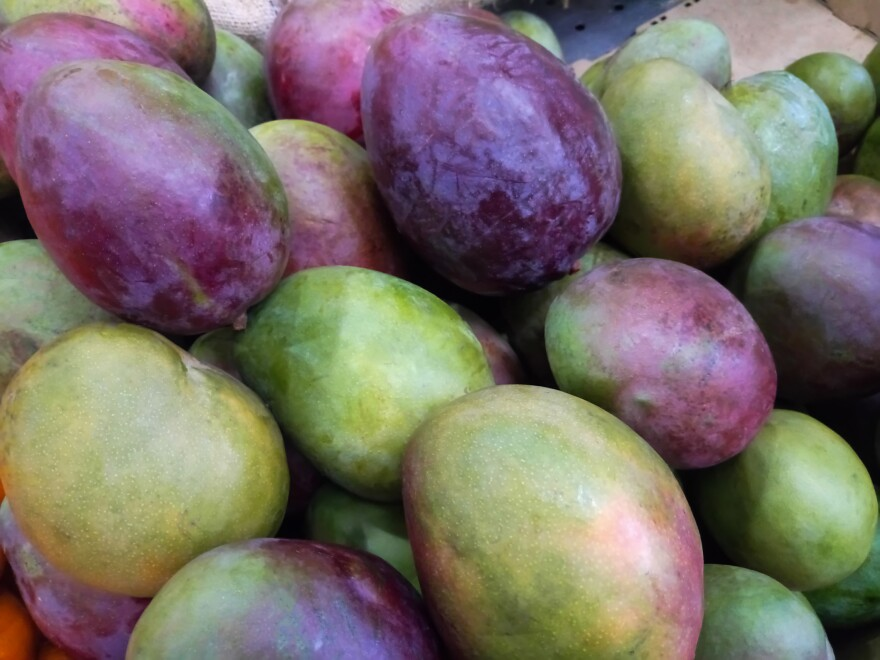 Fresh mangoes at a market stall in Caracas, Venezuela.