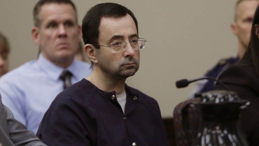In this Jan. 24, 2018 file photo, Larry Nassar sits during his sentencing hearing in Lansing, Mich. Nassar was the USA Gymnastics team doctor and a physician at Michigan State University. In January he was sentenced to prison after pleading guilty to seven counts of sexual assault of minors.