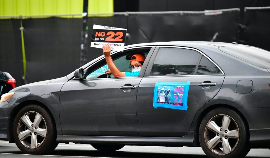 App-based drivers from Uber and Lyft protest against Prop 22 in a caravan in front of City Hall in Los Angeles. The ballot measure was approved by voters and will classify app-based drivers as independent contractors instead of employees.