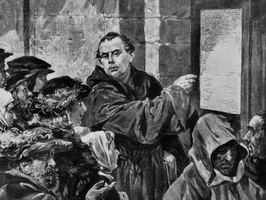 Engraving of German religious reformer Martin Luther posting his 95 Theses on indulgences on the church door at Wittenberg, surrounded by onlookers, Germany, October 31st 1517. (Photo by Authenticated News/Archive Photos/Getty Images)