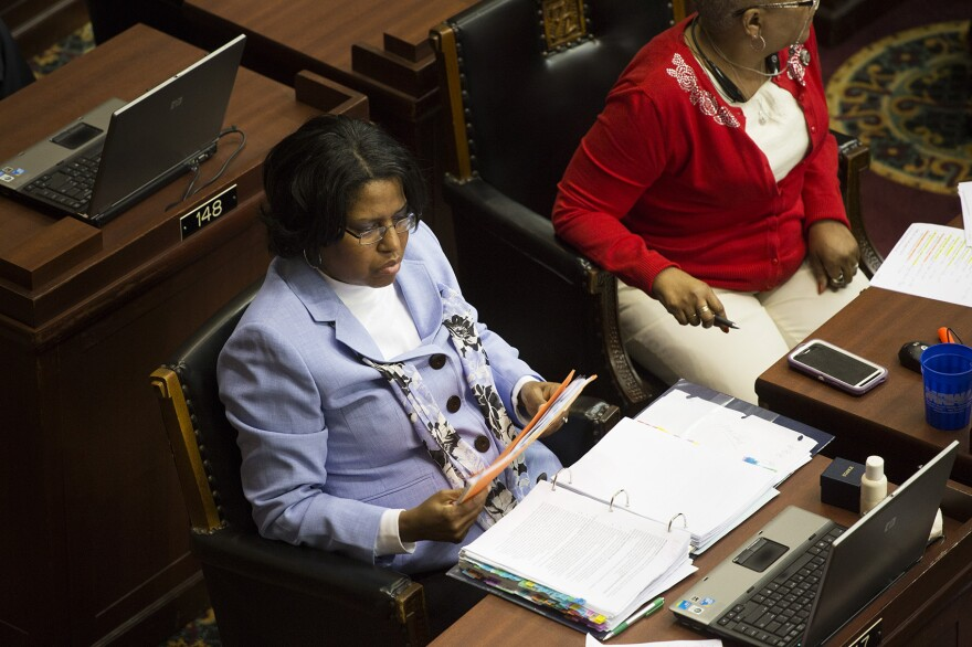 State Rep. Rochelle Walton Gray, D-Black Jack, works during the last few hours of the legislative session.