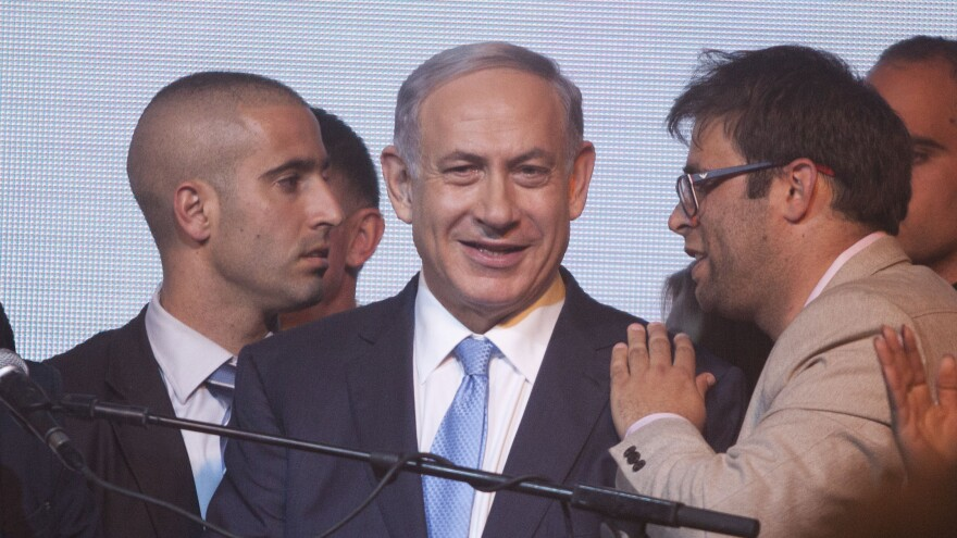 Israeli Prime Minister Benjamin Netanyahu (center) speaks to  supporters at his election headquarters on Tuesday in Tel Aviv. He now appears headed for a fourth term in office, but his campaign pledges could lead to increased friction with the Palestinians, the Obama administration and the international community.