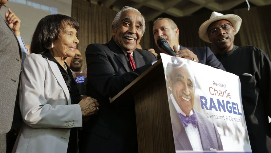 Accompanied by his wife, Alma Rangel, New York Rep. Charles Rangel speaks at his primary election night gathering on Tuesday.