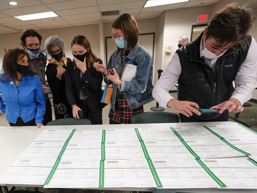 Democratic and Republican canvas observers inspect Lehigh County provisional ballots as vote counting in the general election continued on Friday.
