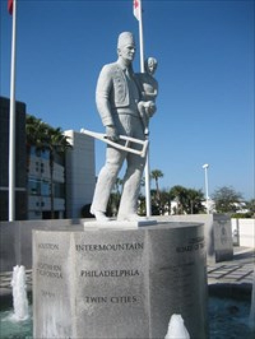 Statue of a Shriner holding a young child outside of the Shriners International Headquarters in Tampa.