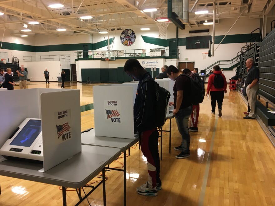 students voting at machines