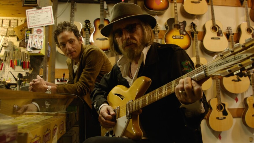 Jakob Dylan (left) and Tom Petty in a still from <em>Echo in the Canyon</em>.