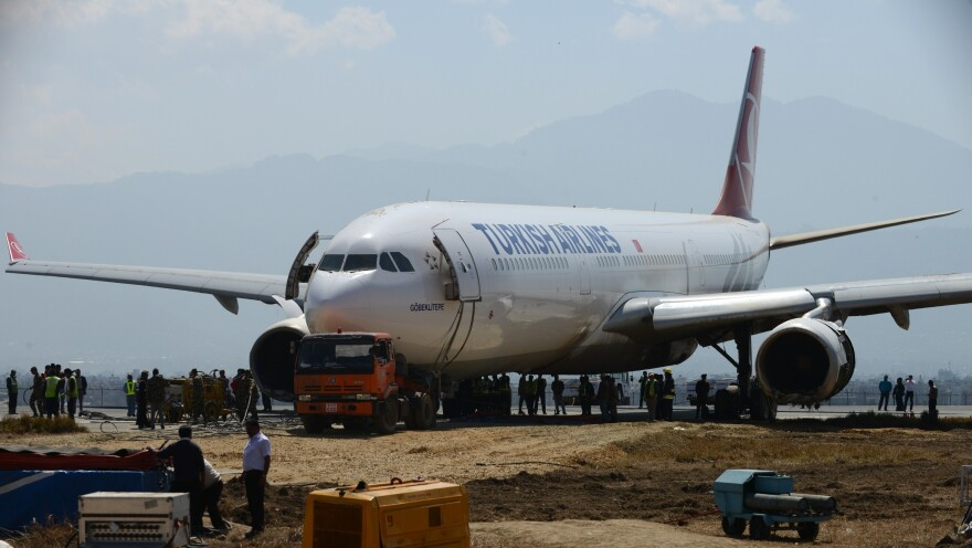 The nose of the Turkish Airlines plane rests on a flatbed tow truck several days after it slid off the tarmac at Kathmandu's international airport.