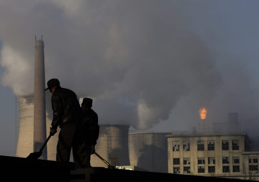 Miners shovel coal at mine in Xiahuayuan county in north China's Hebei province, Friday, Nov. 30, 2007. (Oded Balilty/AP)