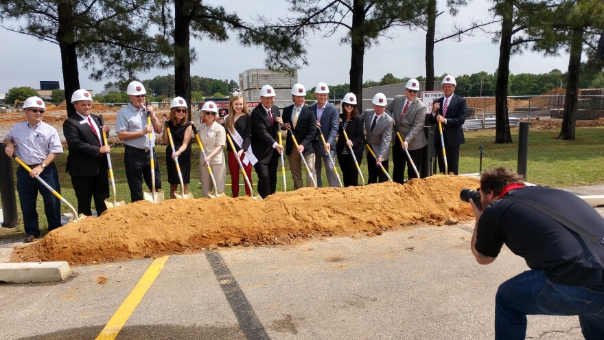 Leaders breaking ground on the new Red Wolf Convention Center and Hotel at the Jonesboro campus of Arkansas State University.