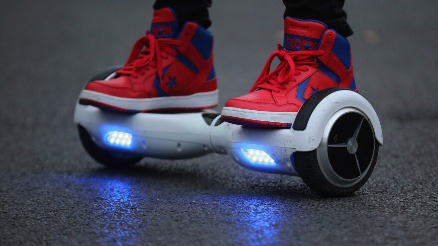 Hoverboards like the one seen here won't be allowed on flights by America's top three airlines, which are citing a potential fire hazard related to the self-balancing scooters' powerful lithium-ion batteries.
