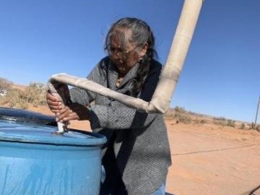 Darlene Yazzie, a retired community health worker, says hauling water, firewood, and trash, and using an outhouse are just a few of the things that make life hard on the Navajo Nation.