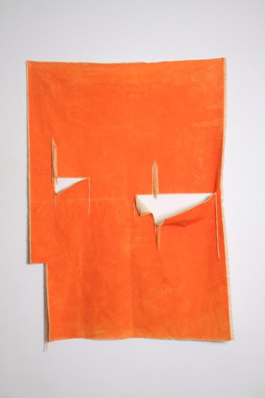 Vaughn Vaughn Davis's Sunset Hills, a ripped and orange canvas hangs from a white wall.
