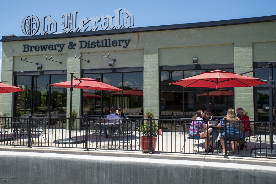 Patrons dine at the Old Herald Brewery and Distillery in Collinsville on May 29. The restaurant can serve customers in-person in phase three of Illinois' reopening plan.  05 29 2020