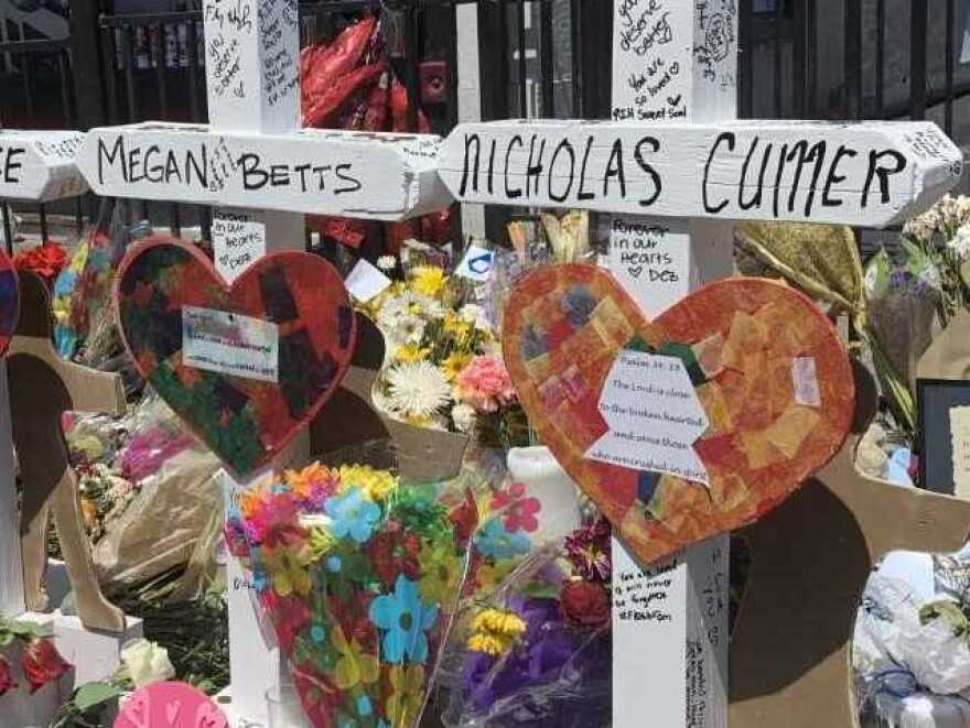 The memorial for victims of the Dayton shooting outside of Ned Peppers, a bar in the city's Oregon District in which a gunman opened fire on Sunday and killed nine people.