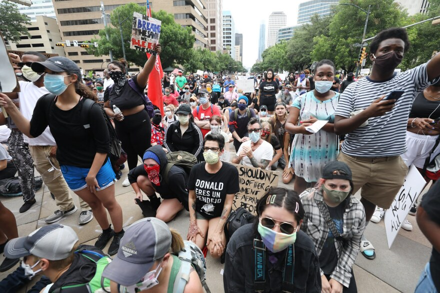 Demonstrators face off with law enforcement in downtown Austin in solidarity with nationwide demonstrations and protests in honor of George Floyd of Minneapolis and, locally, Mike Ramos.