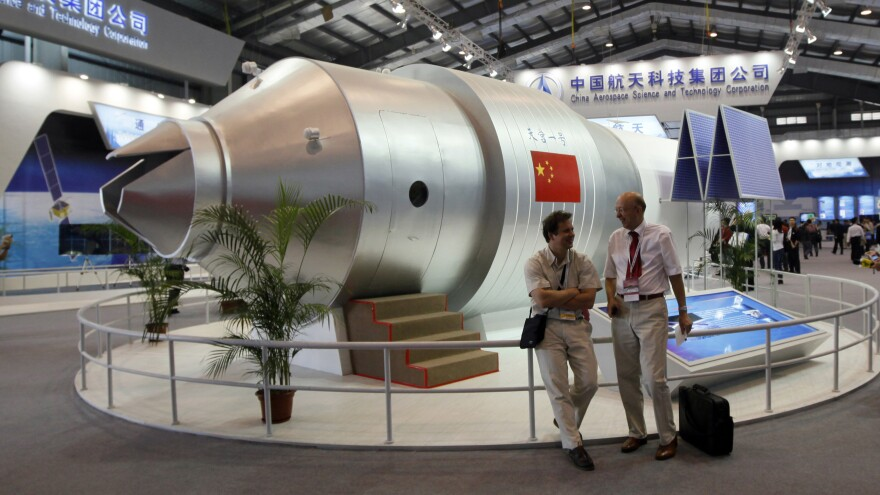 A model of the Tiangong-1 space station at a Chinese airshow in 2010. The real Tiangong-1 will reenter the atmosphere around the end of March.