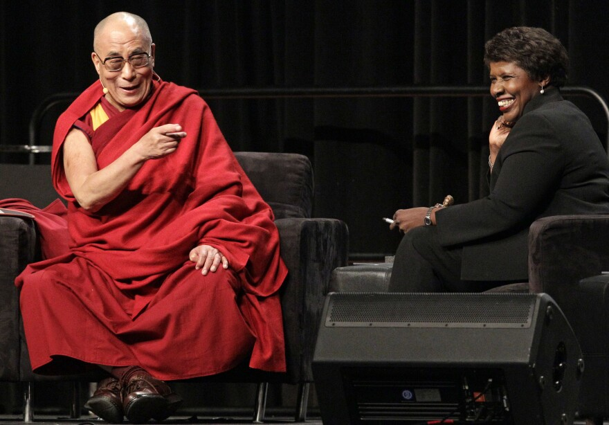 The Dalai Lama answers questions from moderator Ifill in October 2010 at the National Underground Railroad Freedom Center luncheon in Cincinnati.