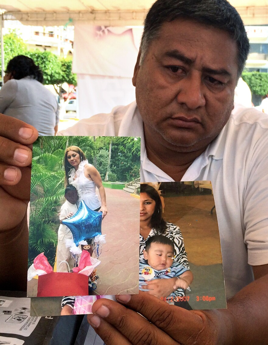Lino Ponce Gonzalez holds photos of his younger sister, who was kidnapped last year just outside Iguala. He says during this Day of the Dead he can relate to the pain and helplessness felt by the relatives of the missing students; he hasn't seen his sister since she was kidnapped. He came to Iguala to help community police in their search for the students.