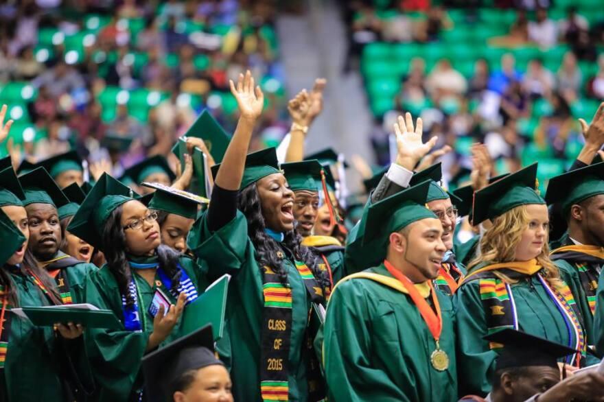 Students celebrate during a FAMU Graduation ceremony