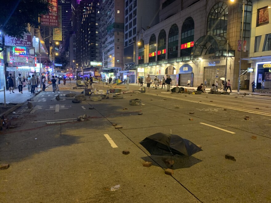As protests in Hong Kong have continued a pattern has emerged. While protests during the day start of peaceful, they usually become violent at night as riot police and protesters clash. Protesters have smashed the storefronts of mainland Chinese banks and businesses and dug up bricks from the sidewalks to slow down the police.