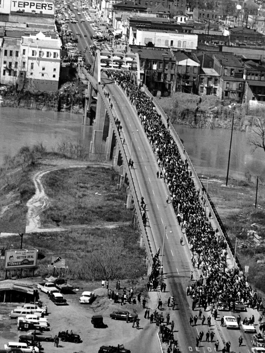 In this March 21, 1965, photo, civil rights marchers cross the Alabama River on the Edmund Pettus Bridge in Selma, Ala., toward the state capital of Montgomery.