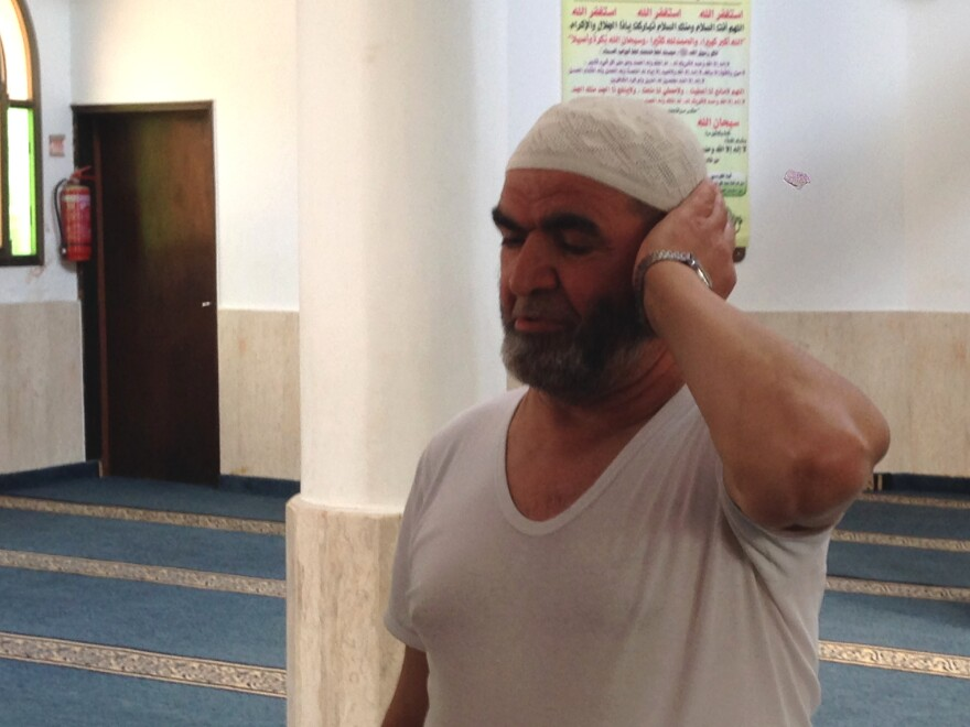 """When we go to Tel Aviv, or to the beach, we see people in different clothing, and nothing happens,"" says Rashid Mansur, who recites the call to prayer five times a day at a Tira mosque."