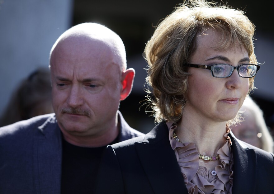 Former U.S. Rep. Gabby Giffords and her husband Mark Kelly attend a news conference  on March 6, 2013 in Tucson, Arizona.