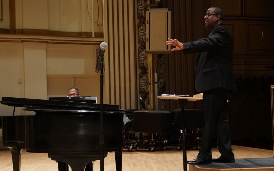 Chorus director Kevin McBeth leads a rehearsal, as pianist Chris White plays.  2/22/19