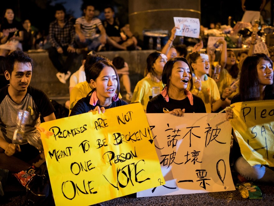 Pro-democracy protesters chant slogans as they gather next to the central government offices in Hong Kong on Wednesday.
