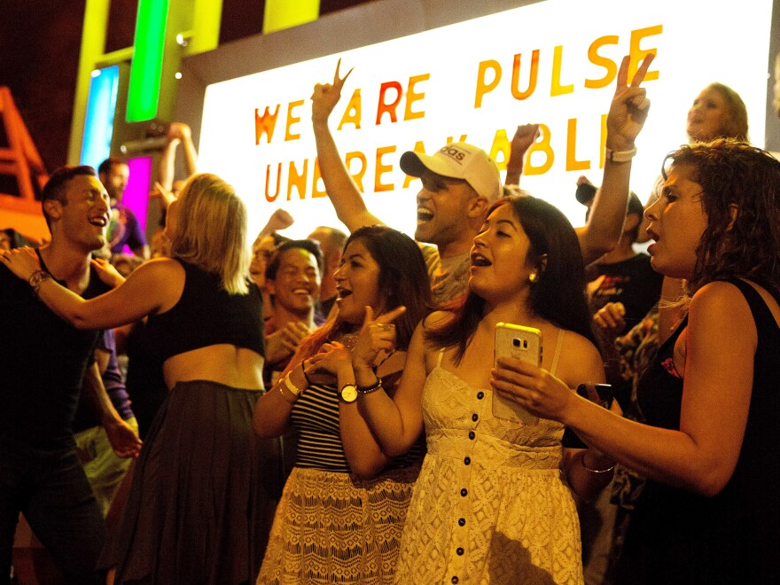 """Club goers dance outside Parliament House, an LGBT nightclub, about a week after the Pulse nightclub mass shooting in Orlando. Pulse's owner has announced a """"Latin Night"""" street party for Thursday, June 23."""