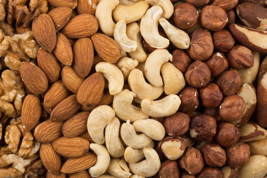 U.S. adults put on about a pound a year on average. But people who had a regular nut-snacking habit put on less weight and had a lower risk of becoming obese over time, a new study finds.