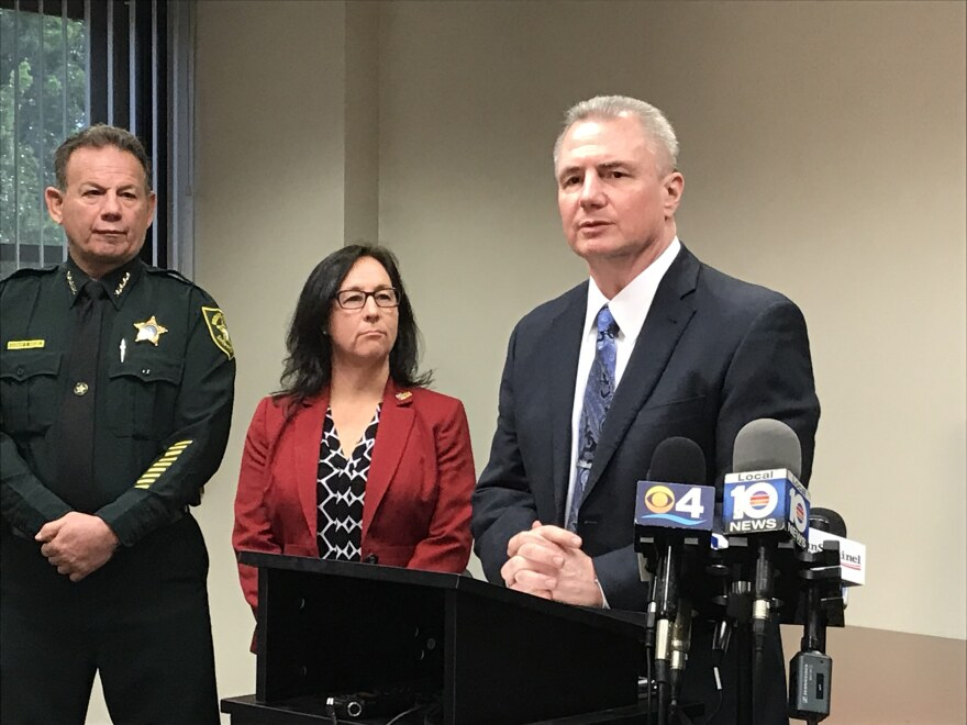 Mark Gale, the FLL airport director, stood with members from the airport workers union, and Broward County Sheriff Scott Israel at the bill announcement.