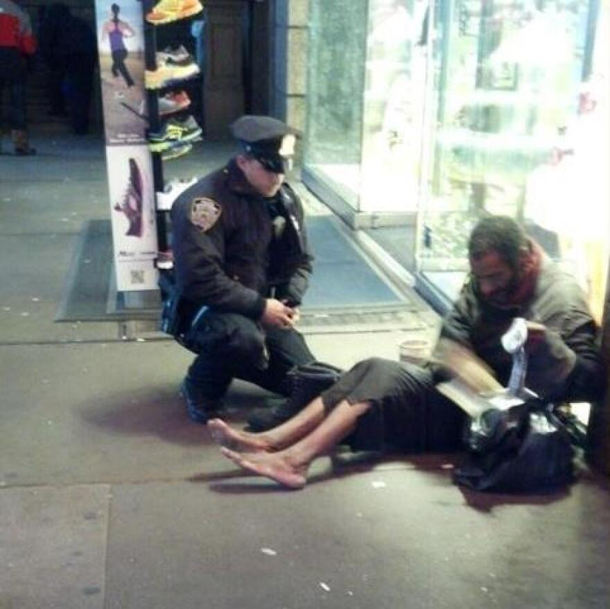The photo that touched many hearts: New York City Police Officer Lawrence DePrimo gives a shoeless man a pair of boots on a frigid night last month. That man was later identified as 54-year-old Jeffrey Hillman.
