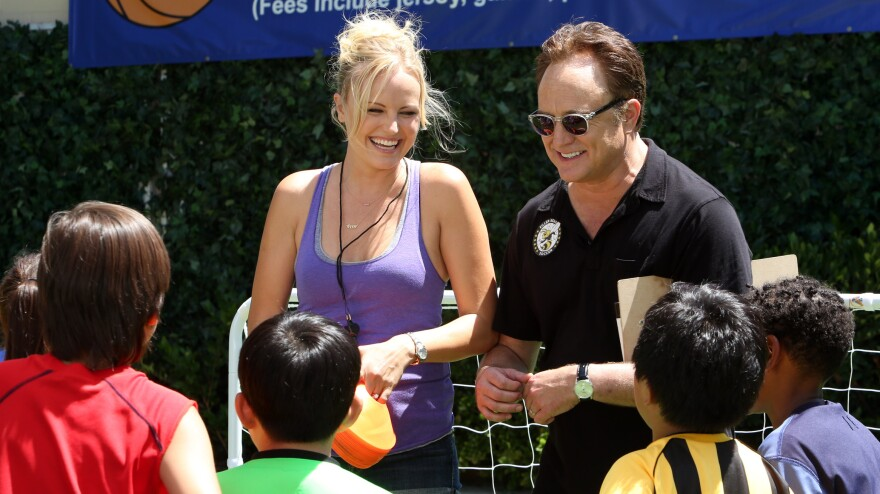 Kate (Malin Akerman) pitches in alongside husband Pete (Bradley Whitford) on her stepson's soccer practice in ABC's <em>Trophy Wife</em>.