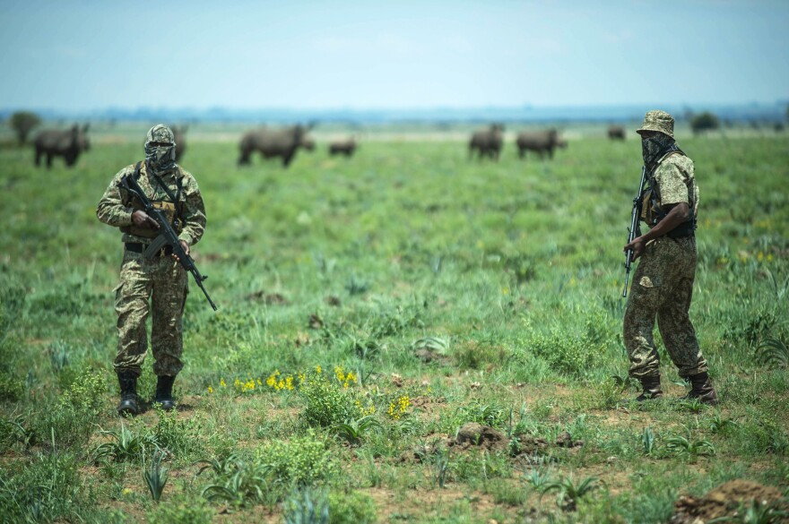 An anti-poaching rhino unit patrols at Hume's rhino ranch in Klerksdorp, South Africa, on Feb. 3. Hume spends more than $200,000 a month in security to protect his animals from poachers.