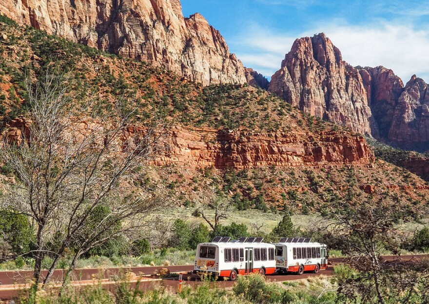 A photo of the shuttle buses at Zion National Park.