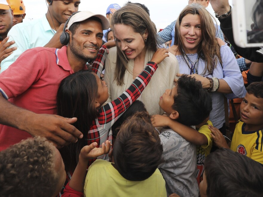 UNHCR special envoy Angelina Jolie greets Venezuelan migrants at a U.N.-run camp in Maicao, Colombia, on the border with Venezuela. Jolie visited the camp to learn more about the conditions faced by migrants and refugees and raise awareness about their needs.