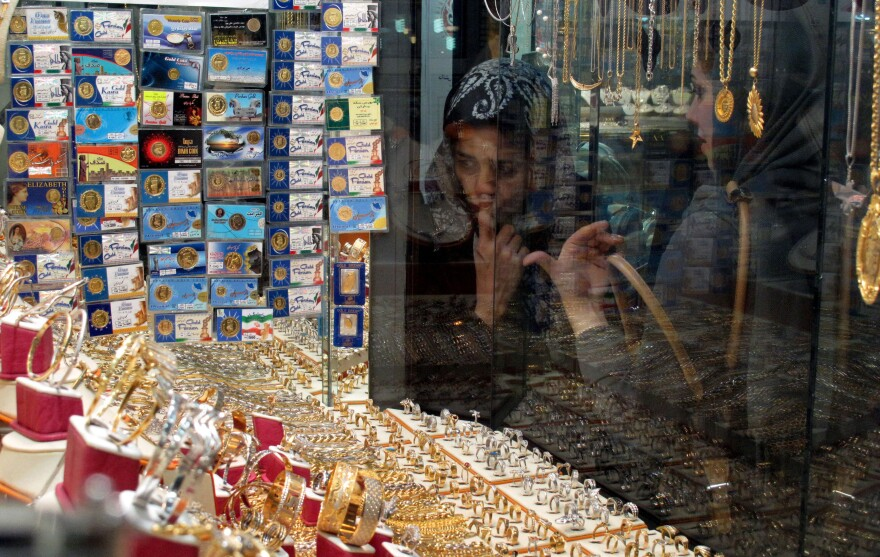 Iranian women look at a jewelry shop display in Tehran, Iran, in 2010. Iran now appears to be stockpiling gold in an attempt to stabilize its economy, which has been hit hard by Western sanctions.