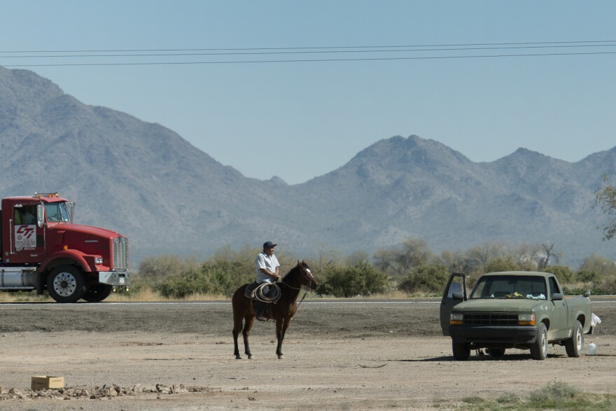 A road through the Gila River Indian Community in 2014. The tribe is one of 17 tribal governments the U.S. government announced Monday it had settled lawsuits with, over alleged mismanagement of land and resources.