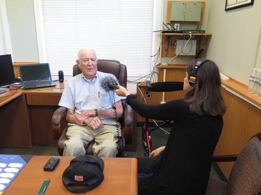 Charlie Jones being interviewed by Roxy Todd