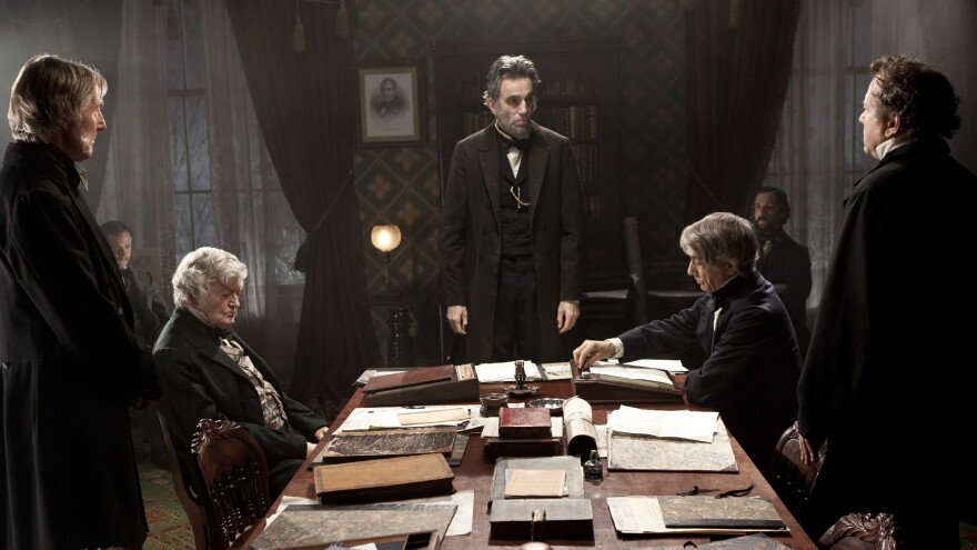 Daniel Day-Lewis (center) portrays Abraham Lincoln in the film <em>Lincoln</em>, which might leave audiences feeling a little more hopeful about the state of today's Congress.
