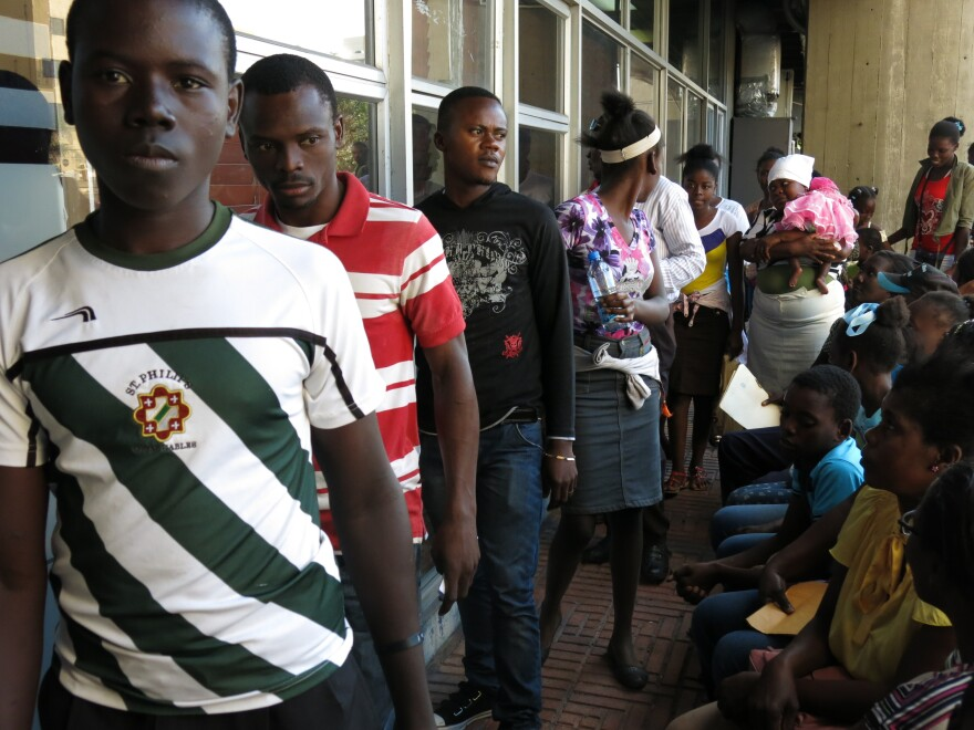 People of Haitian descent born in the Dominican Republic stand in line to apply for a birth certificate listing them as foreigners in the Dominican Republic. Those who did not meet the Feb. 1 deadline are now stateless.